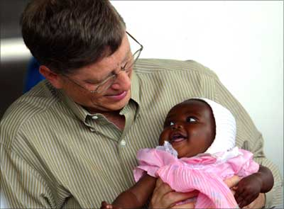 Bill Gates holds baby girl Cecil Massango during his visit to a health centre in Mozambique.
