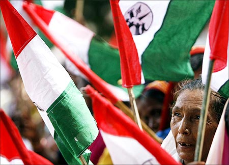 A woman holds a flag during a demonstration against SEZ in Maharashtra.