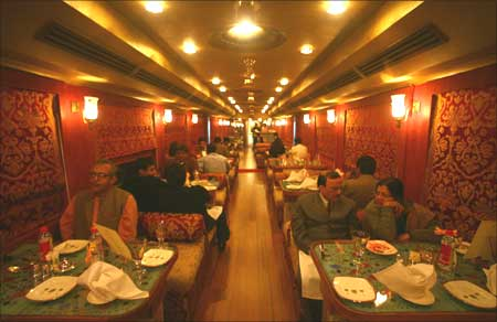 Guests have their dinner at the 'Swarna Mahal' dining coach of the luxury train 'Royal Rajasthan'