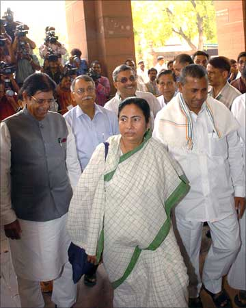 Union Minister for Railways, Mamata Banerjee arrives at Parliament House along with her deputies E Ahamed and K H Muniyappa to present the Rail Budget 2009-10, in New Delhi on July 03, 2009.
