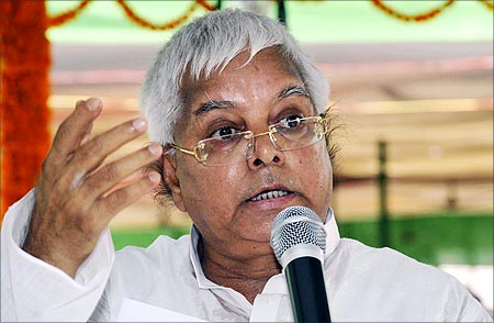 Lalu Prasad Yadav speaks during a meeting with his party workers in Patna.