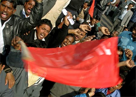 Employees of the Airports Authority of India shout slogans during a protest in New Delhi.