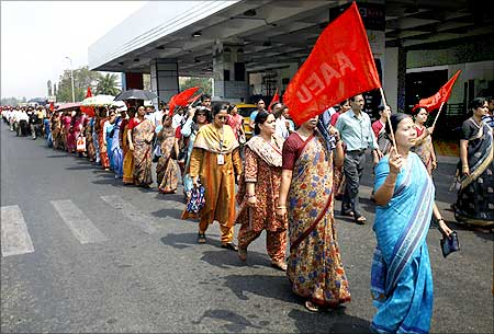 Employees of the Airports Authority of India march outside the airport during a protest in Kolkata.