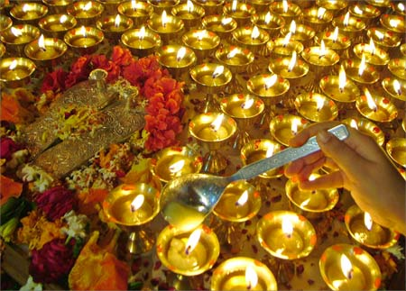 A devotee lights lamps during the Navratri festival at a temple in Amritsar.