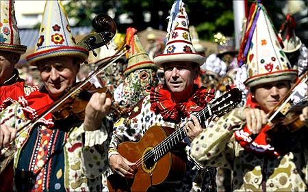 People dressed as Flinserl participate in a parade during the daffodil festival in the Austrian village of Bad Aussee.