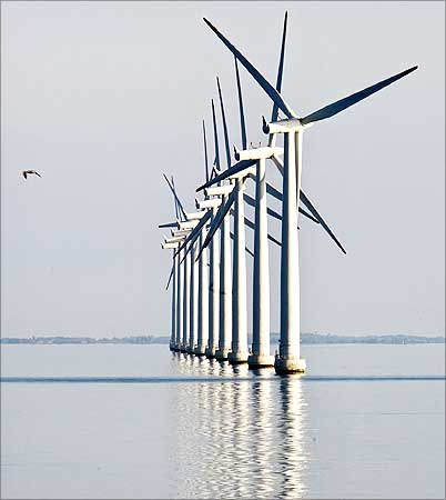 An off-shore wind farm stands in the water near the Danish island of Samso.