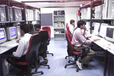 Software engineers work at the Microsoft India data centre in Hyderabad.
