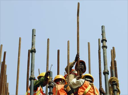 Labourer work at a construction site of a flyover in New Delhi.