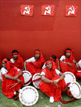 Women naxalites wait before their performance during a protest rally.