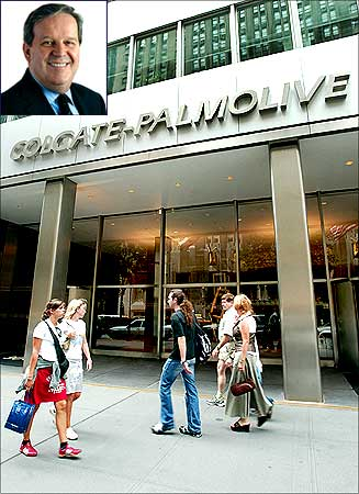 People pass the entrance of Colgate-Palmolive World headquaters in New York , Ian M Cook (Inset).