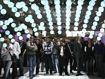 Visitors watch a presentation about cloud computing at the IBM booth at the CeBIT computer fair.