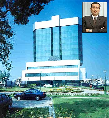 Dabur's Corporate Office. Amit Burman (Inset)