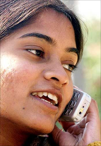 A woman uses a cell phone.