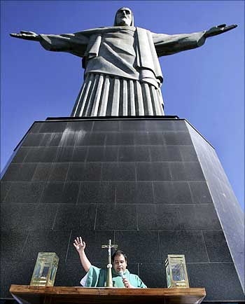 A priest holds a mass at the base of the Christ the Redeemer statue in Rio de Janeiro.