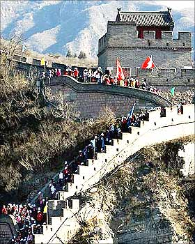 People carrying AIDS awareness flags walk along the Great Wall of China located near Beijing.