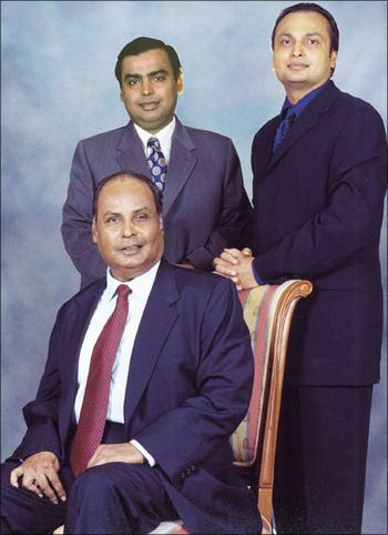 Mukesh Ambani (L-standing), Anil Ambani (R-standing) and their father Dhirubhai Ambani (seated) at their residence in Mumbai in November 2000.