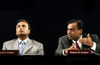 Mukesh Ambani and his brother, Anil, at an RIL AGM in Mumbai in June 2004.