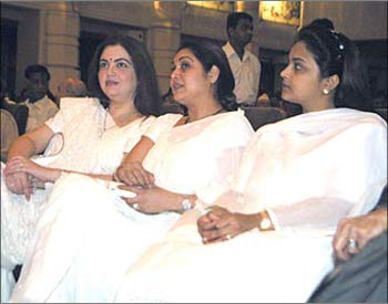 Mukesh Ambani's wife Nita (left) with Anil's wife Tina (centre).