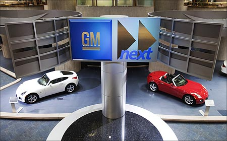 Cars are seen on display inside the General Motors Corp world headquarters in Detroit.