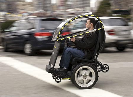 The Project P.U.M.A. prototype is shown during a test drive in Brooklyn, New York in April 2009. General Motors and Segway are developing an electric two-seat prototype vehicle with just two wheels, which could allow people to travel around cities more quickly, safely, quietly and cleanly, and at a lower total cost.