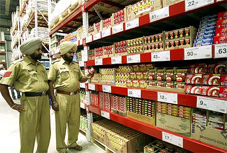 Policemen stand inside the first cash-and-carry Wal-Mart store during its inauguration in Amritsar.