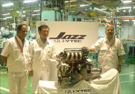 Top honchos of Honda Siel Cars India at the unveiling of Honda Jazz 1.2 L i-VTEC engine.