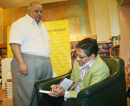 Parag Parikh signs a book.