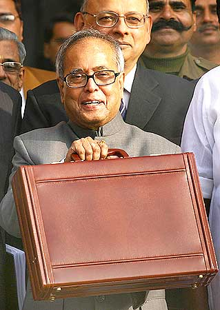 Pranab Mukherjee smiles as he leaves his office to present the 2009/10 interim budget in New Delhi