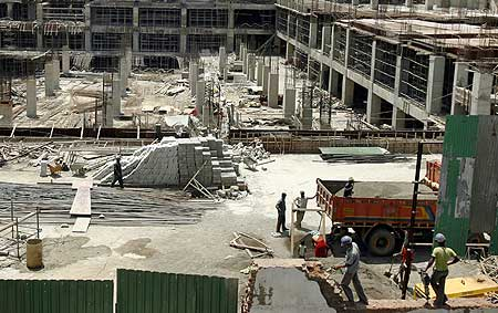 Labourers work at the construction site of a building in Mumbai.