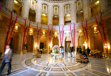 Guests walk through the lobby of Umaid Bhawan Palace and hotel, Jodhpur.