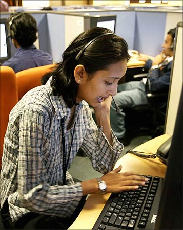 Indian employees at a call centre provide service support to international customers.