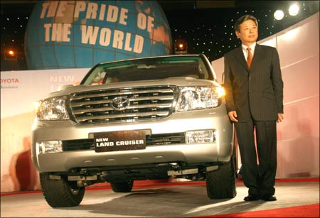 TKM managing director Hiroshi Nakagawa poses with Land Cruiser.