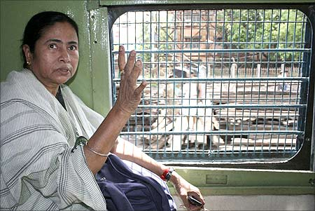 Mamata Banerjee travels on a local train during her visit to a cyclone devastated site near Kakdeep