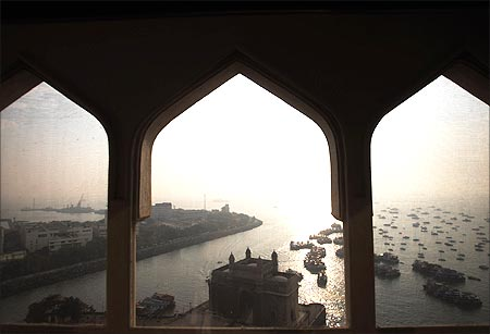 Gateway of India is seen through the window of a room in the Taj Mahal hotel in Mumbai.