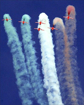 Indian Air Force Suryakiran jet trainers perform during the Aero India 09 in Bangalore