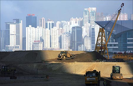 Bulldozers work on reclaimed land in Hong Kong.