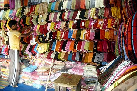A vendor arranges woollen garments at a street market in Agartala, Tripura.