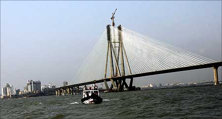 A boat sails past the Bandra-Worli sea link in Mumbai.