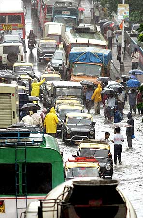 Vehicles are stuck in traffic jam due to flooded roads in Mumbai.