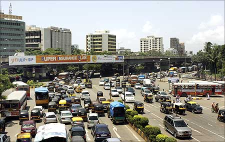 Vehicles move during busy traffic hours in India's financial hub Mumbai.