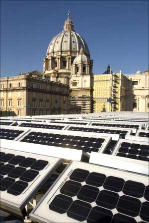 Solar panels cover the roof of the Paul VI hall near the cupola of Saint Peter's Basilica at the Vatican.