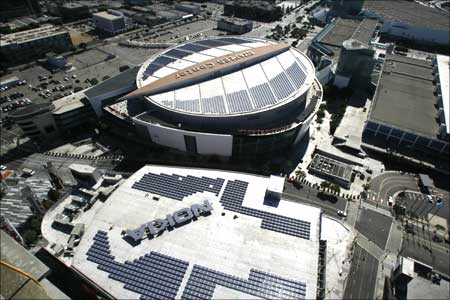 Solar panels are seen atop the roofs of the Nokia Theatre and Staples Center at LA.