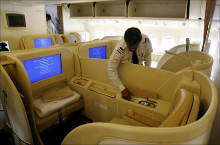 An official looks at the newly introduced first class cabin section in Air India's new Boeing 777-20