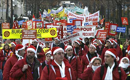 French tobacconists, wearing Santa Claus costumes, demonstrate to protest against a smoking ban.