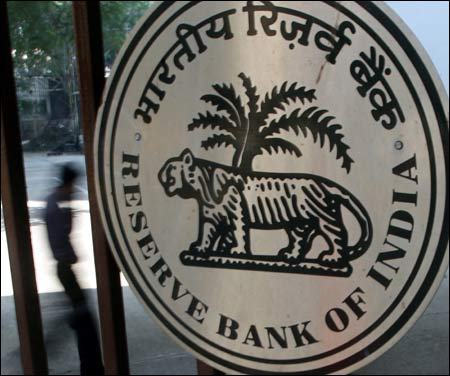 Reserve Bank of India emblem.