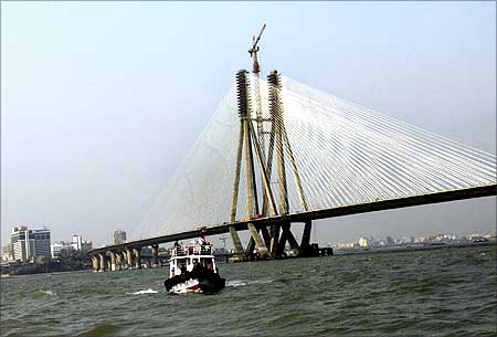 A boat sails past the Bandra-Worli sea link.