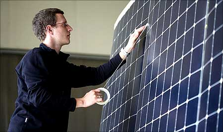 A team member works on the photovoltaic cells.