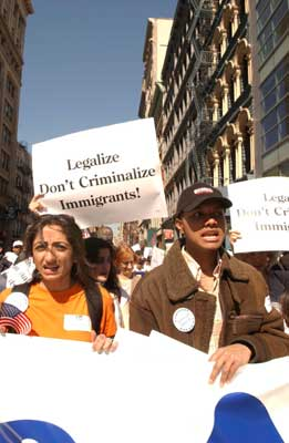 Protestors march and shout as they rally in New York for immigration rights.   Photograph: Paresh Gandhi/Rediff Archives