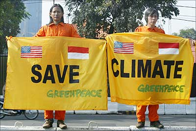 Greenpeace activists hold a banner urging world leaders to save the climate.