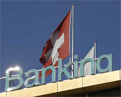 A Swiss flag is pictured on top of the Dresdner Private Banking building in Geneva.